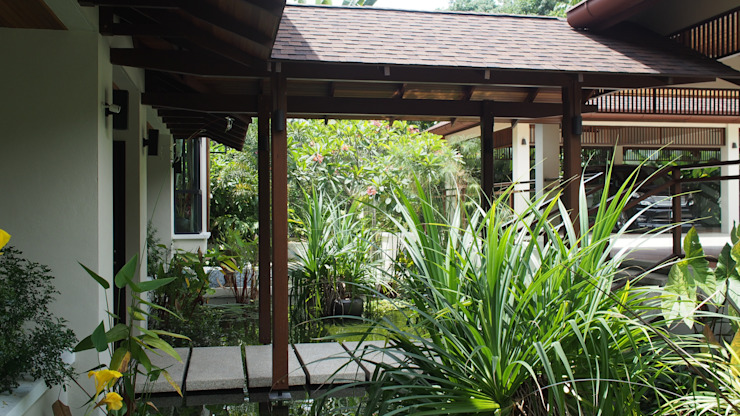 Luxury Bungalow In Sungai Penchala Kuala Lumpur Tropical style gardens by Mode Architects Sdn Bhd Tropical