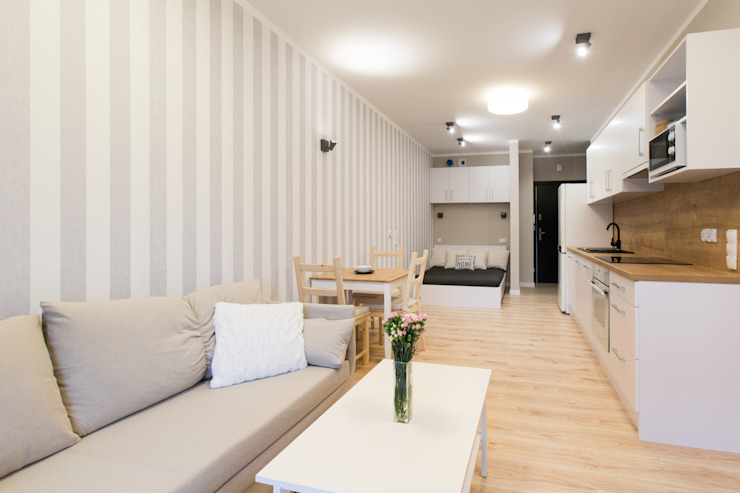 Livings modernos: Ideas, imágenes y decoración de in2home Moderno Compuestos de madera y plástico