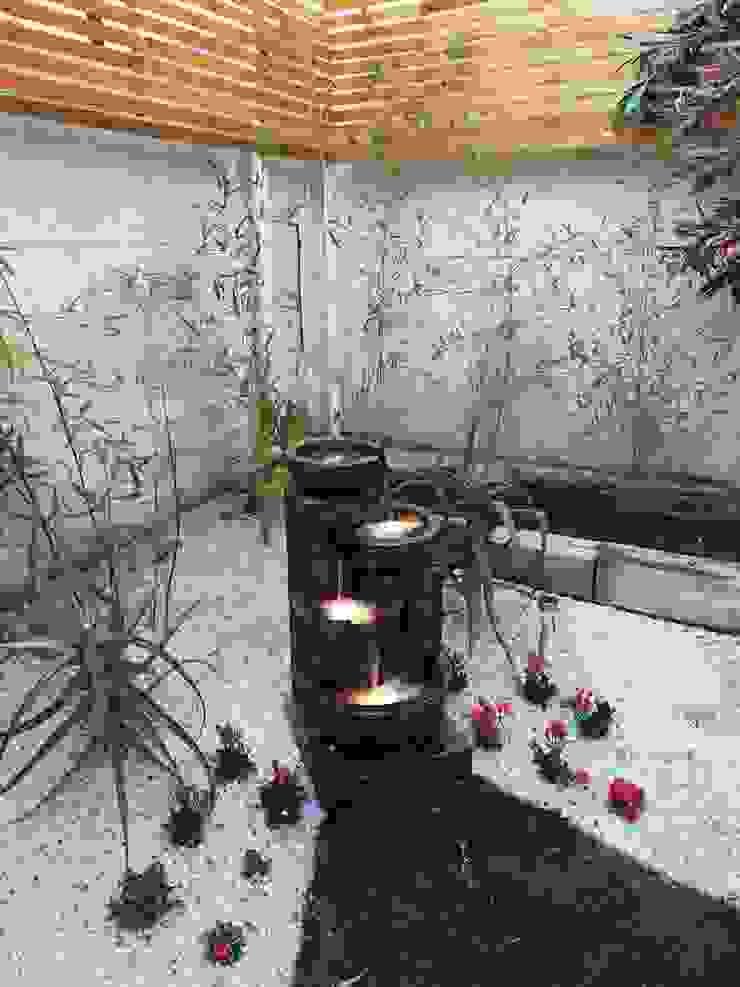 DESPUÉS - FUENTE - ILUMINACIÓN EXTERIOR HZ ARQUITECTOS SANTIAGO DISEÑO COCINAS JARDINES PAISAJISMO REMODELACIONES OBRA Jardines de estilo minimalista
