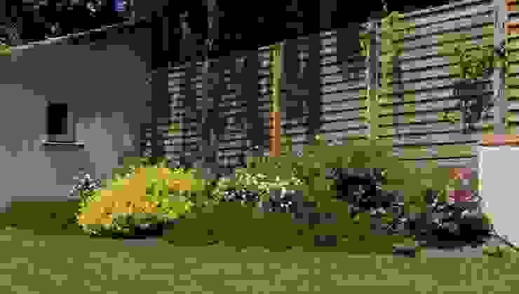 Claustra bois Jardin moderne par Constans Paysage Moderne Bois Effet bois