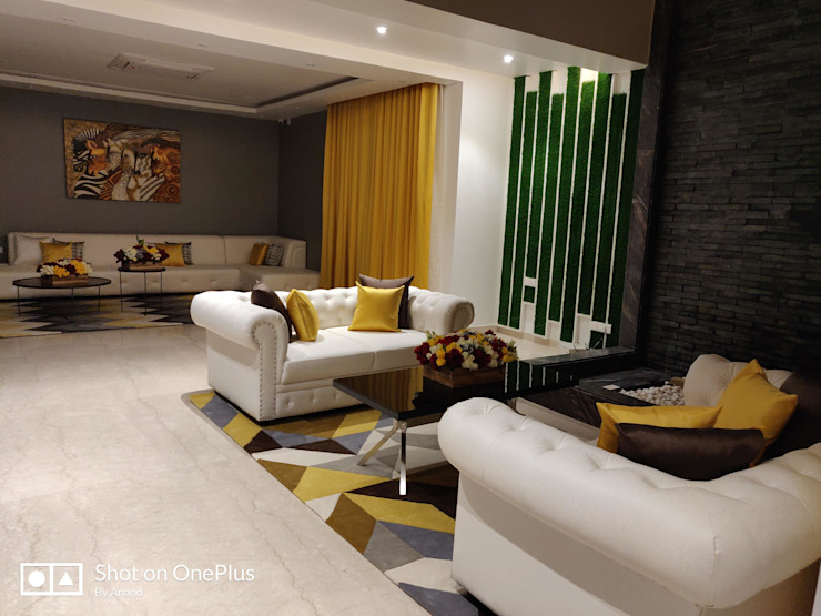 Drawing and Living space Together creates an amazing Open space !:  Living room by Enrich Interiors & Decors,