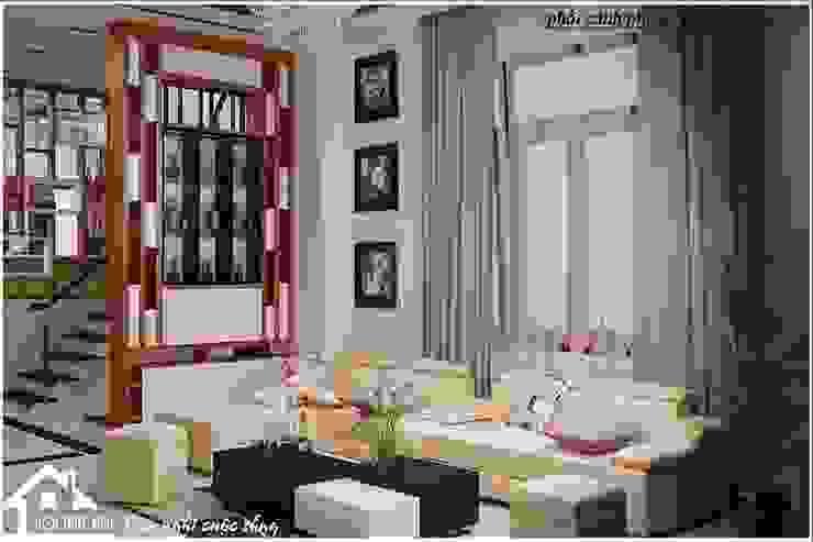 Bộ ghế sofa da tiện nghi trong phòng khách bởi NỘI THẤT XINH