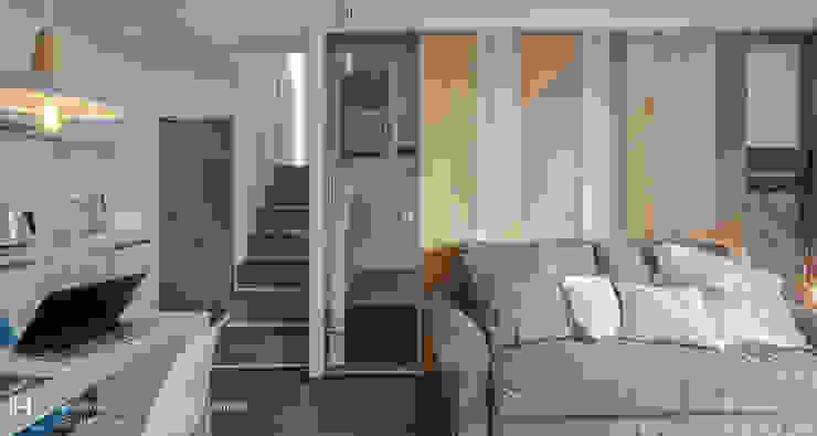 樓梯上去通往另一間臥室,廚房旁的玻璃門則是通往衛浴,其上方是儲藏室: 現代  by SECONDstudio, 現代風