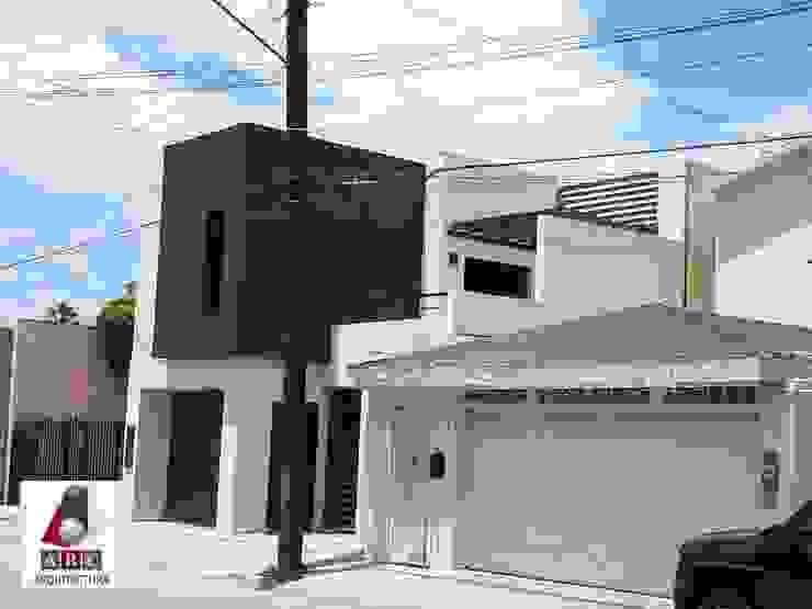 Fachada actual ARC ARQUITECTURA Casas unifamiliares Concreto reforzado Multicolor