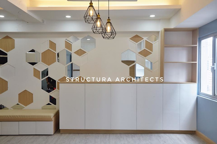 Low Storage Cabinet and Accent Wall by Structura Architects Modern
