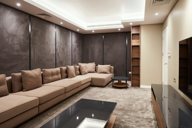 Spacious cinema room by Urbanist Architecture Modern Marble