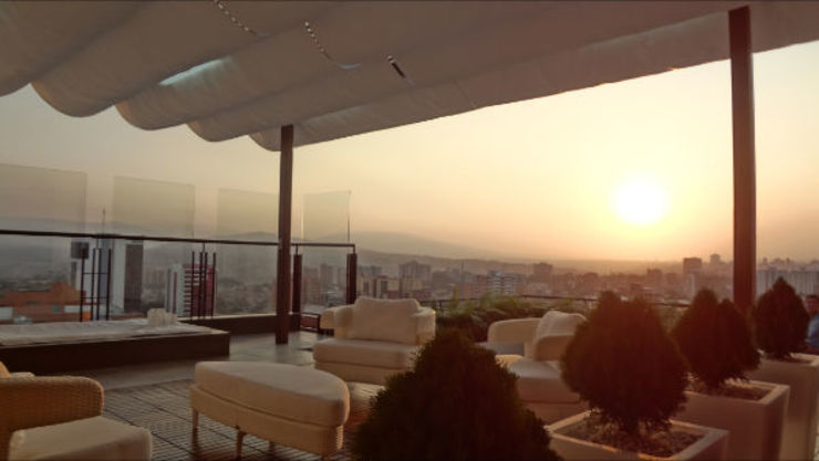 Vista Terraza Balcones y terrazas de estilo tropical de AUTANA estudio Tropical Concreto
