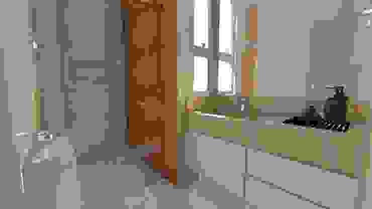 Banheiro suite: Banheiros  por Fark Arquitetura e Design,