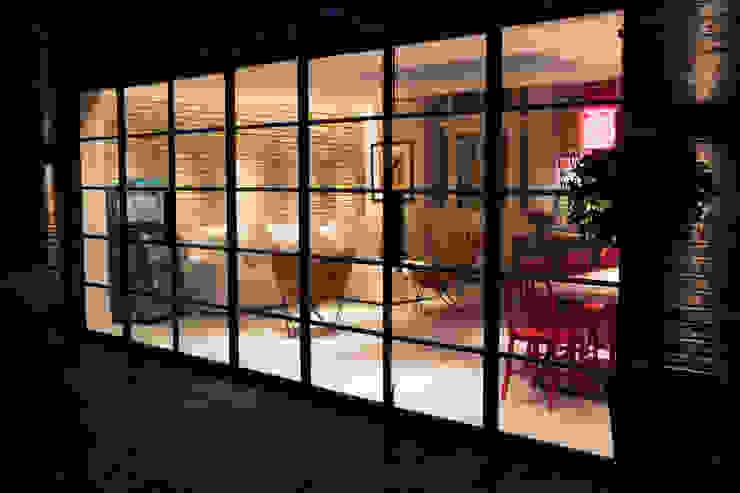 Steel Frame Glass Door MB Masterbuilders Ltd. Industrial style houses