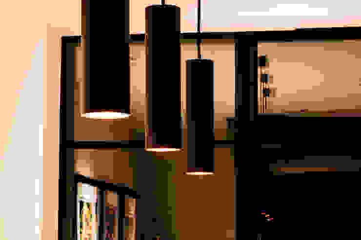 Contemporary Lighting MB Masterbuilders Ltd. Industrial style dining room