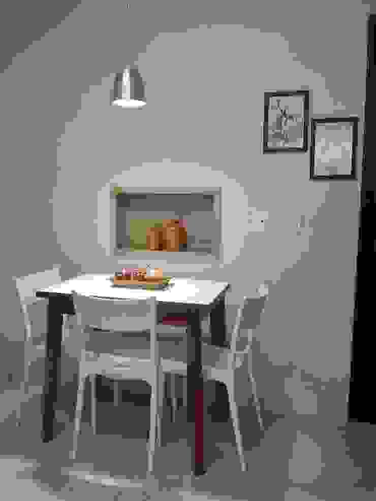 Espaço do café por Izabella Biancardine Interiores Moderno