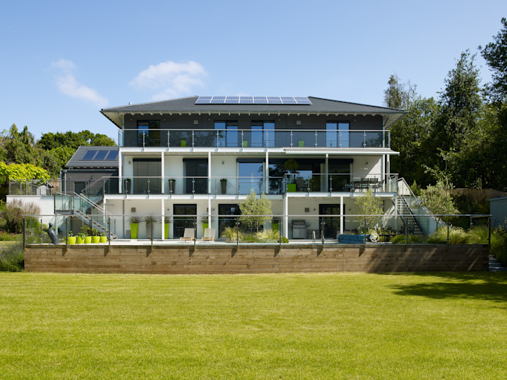 House Bond by Baufritz Baufritz (UK) Ltd. Garden Plants & flowers Concrete Beige