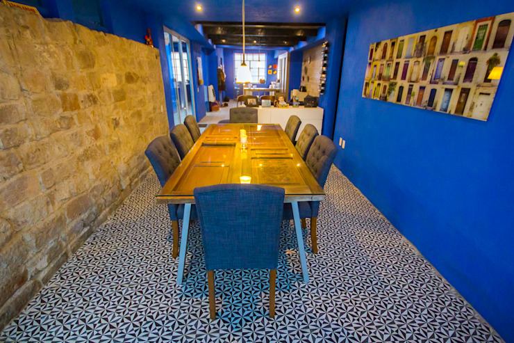 Eclectic style dining room by ÖQ Arquitectos Eclectic