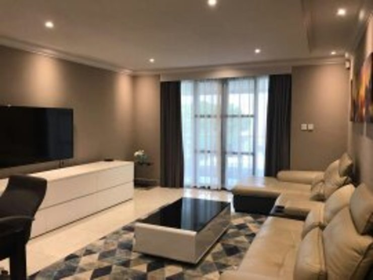 Completed Modern living room by Space Factory Architecture (Pty) Ltd Modern
