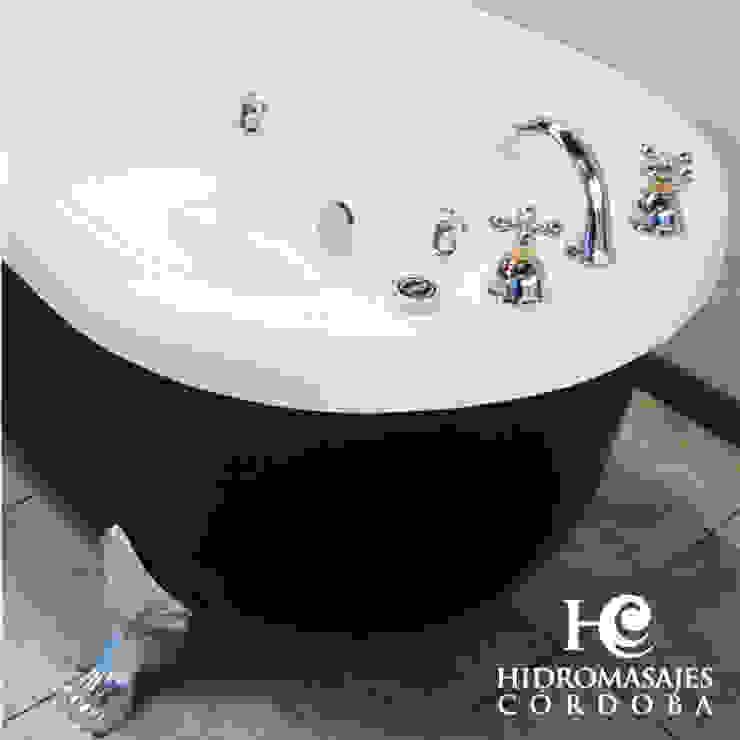 TINA ANTIGUA CON HIDROMASAJE: Baños de estilo  por Hidromasajes Córdoba,
