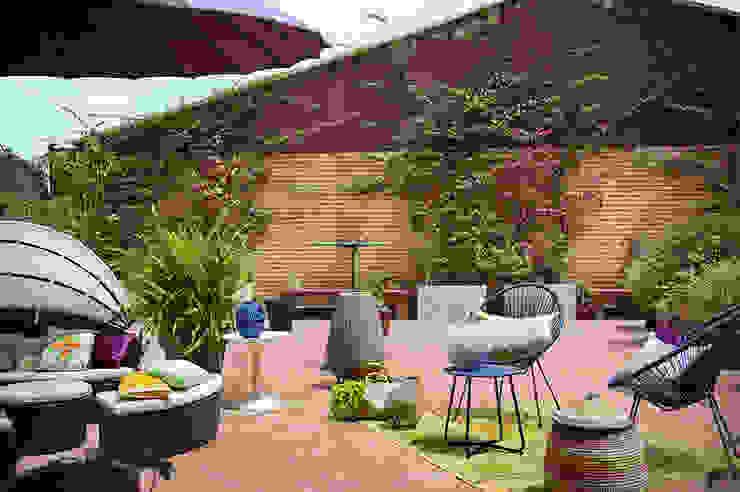 La Casa Bipolar Balcones y terrazas de estilo ecléctico de Egue y Seta Ecléctico