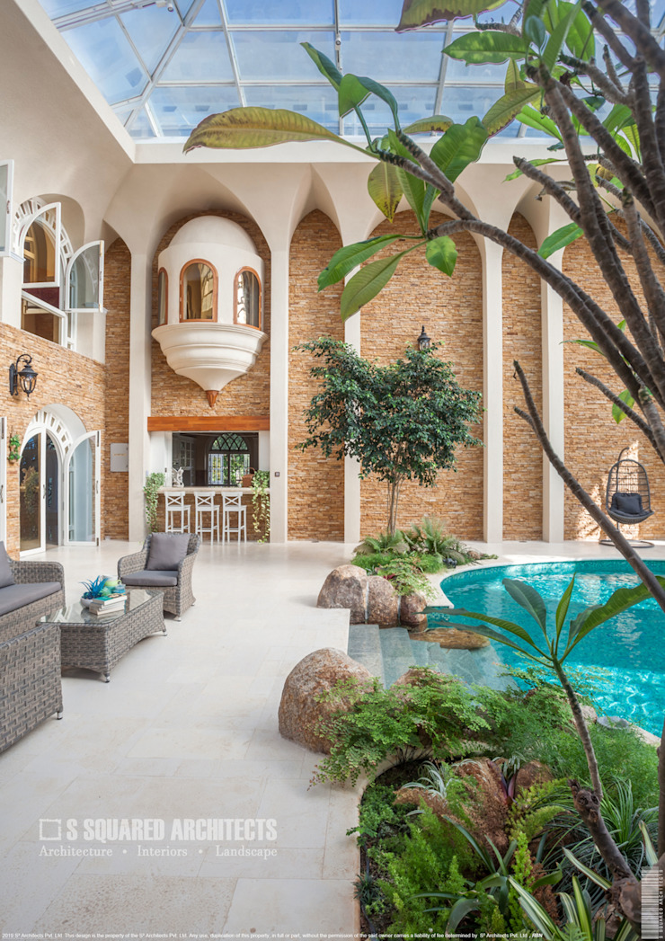 The 'Golden Hue' Residence Colonial style pool by S Squared Architects Pvt Ltd. Colonial Bricks