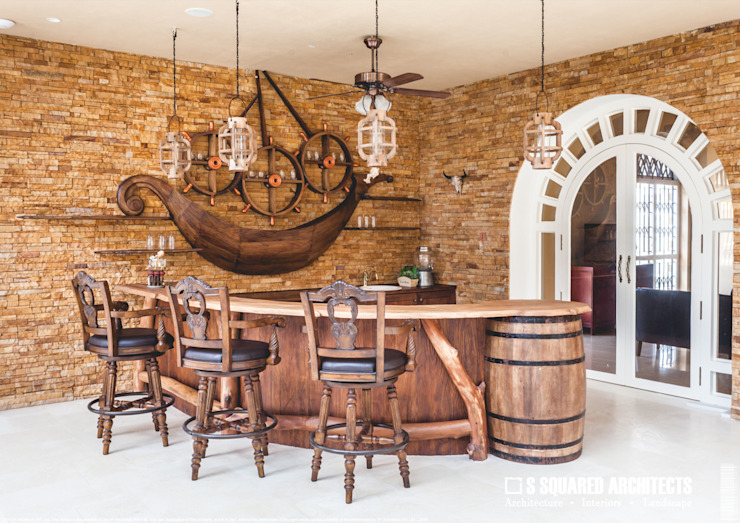 The 'Golden Hue' Residence :  Wine cellar by S Squared Architects Pvt Ltd.,Colonial Solid Wood Multicolored