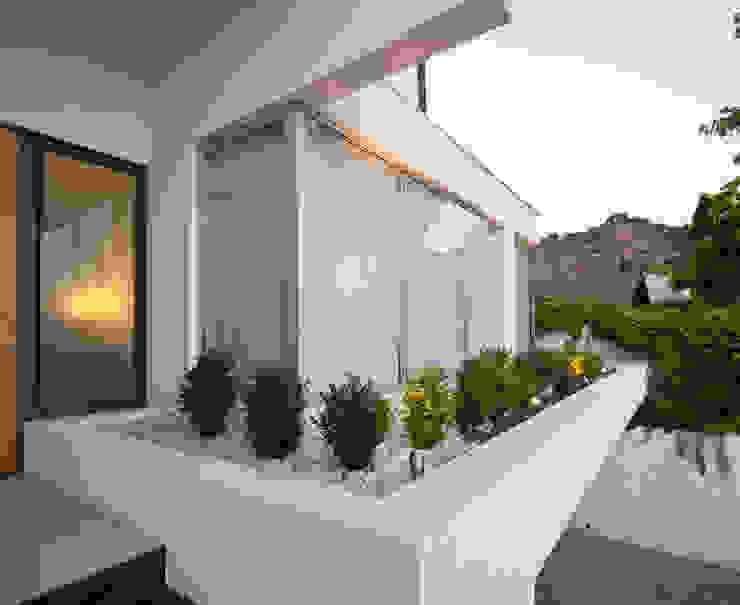 Fachada [ER+] Arquitectura y Construcción Casas unifamiliares