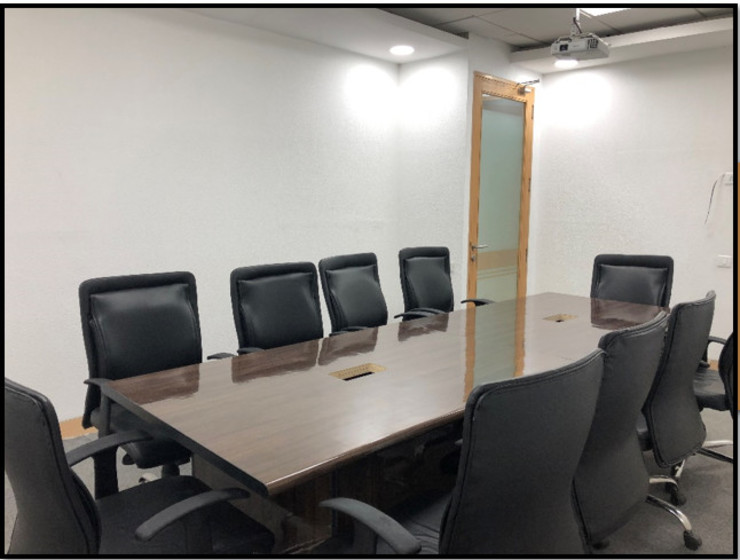 Conference room:  Offices & stores by Ecoinch Services Private Limited,Modern