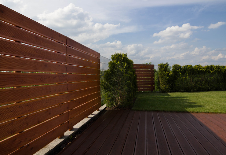 Balkon, Beranda & Teras Modern Oleh Bednarski - Usługi Ogólnobudowlane Modern