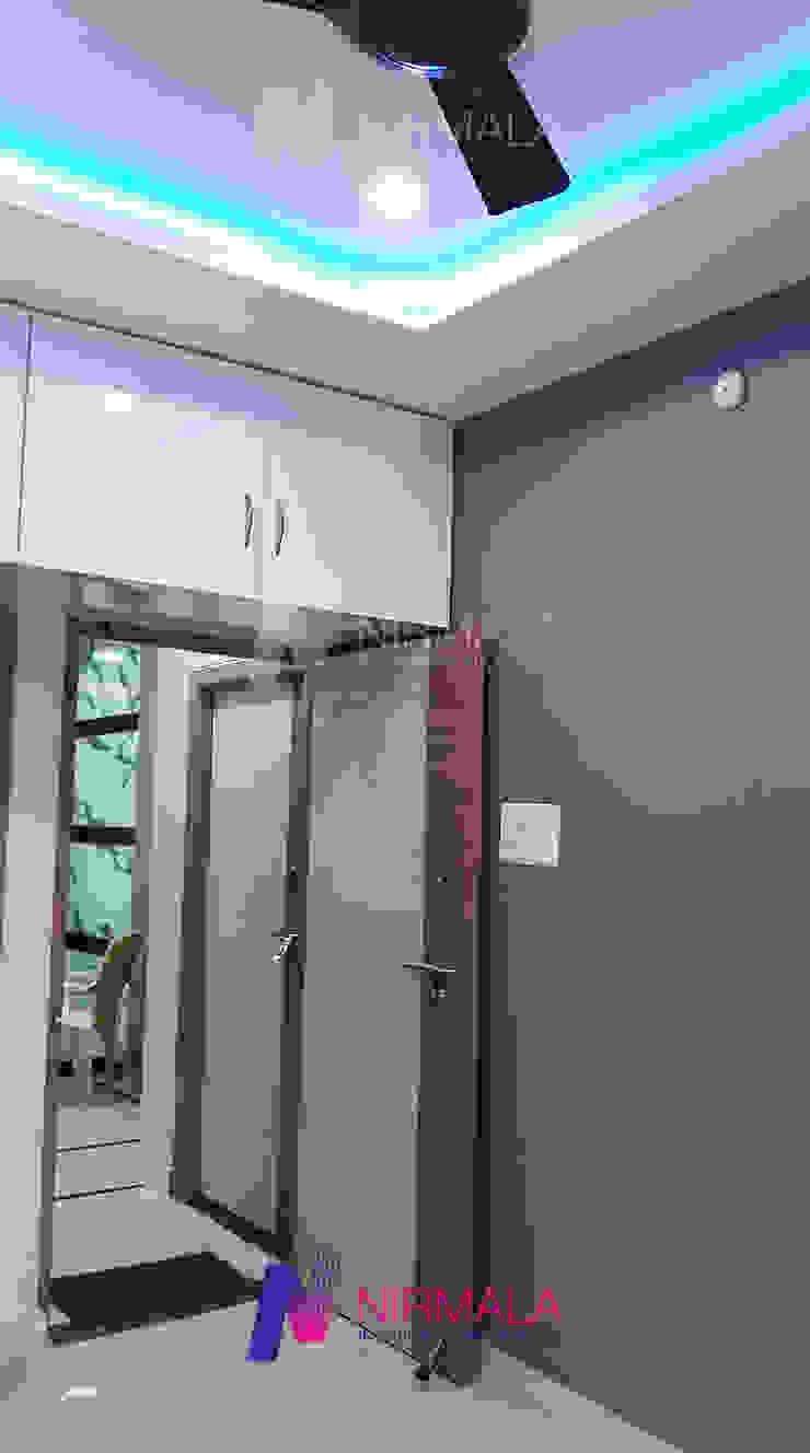 Nirmala Architects & Interiors BedroomWardrobes & closets