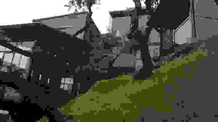 CASA ESTILO INDUSTRIAL BOSQUE TZALAM: Casas ecológicas de estilo  por ARQ. FRANCISCO GODINEZ ALVA,