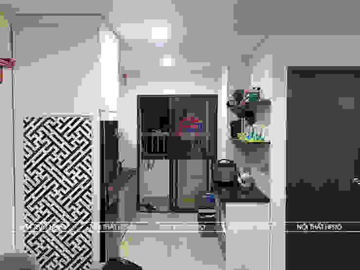 Ảnh chụp thực tế bộ tủ bếp acrylic kết hợp laminate nhà anh Tú - Ngọc Hồi: hiện đại  by Nội thất Hpro, Hiện đại
