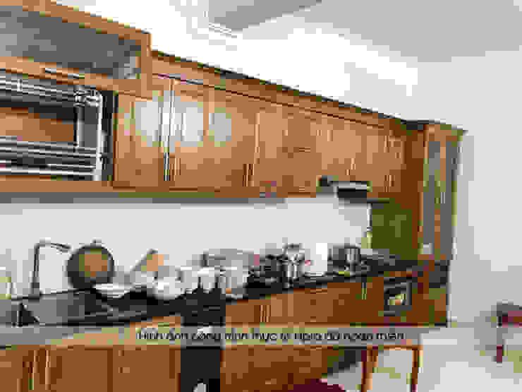 Hình ảnh thực tế bộ tủ bếp gỗ sồi mỹ kèm tủ rượu nhà chị Thập - Hải Phòng: hiện đại  by Nội thất Hpro, Hiện đại