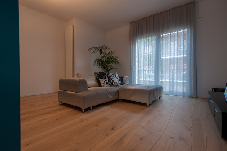 Zona divano: Pavimento in stile  di Bolefloor , Moderno Legno Effetto legno