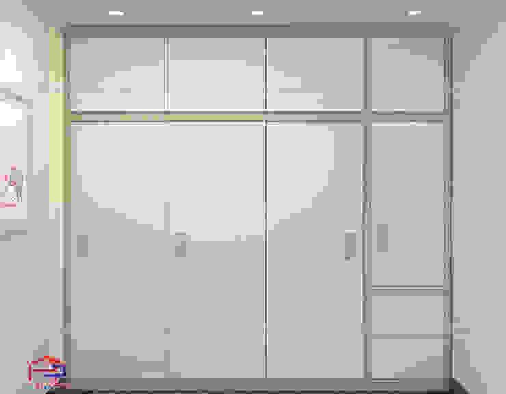 Hình ảnh thiết kế 3D tủ quần áo trong không gian phòng ngủ bé gái nhà chị Thắng - Goldmark City: hiện đại  by Nội thất Hpro, Hiện đại