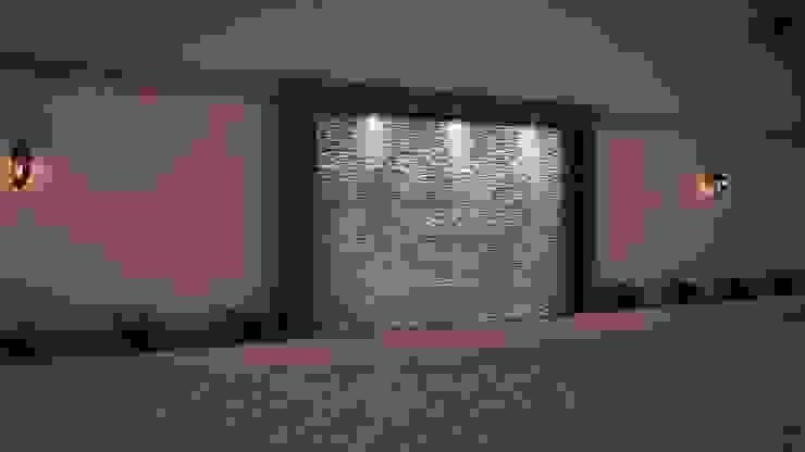 Remodelacion de muro de Colindancia y Fabricacion de Muro Lloron Balcones y terrazas mediterráneos de MSG Architecture SA DE CV Mediterráneo Piedra