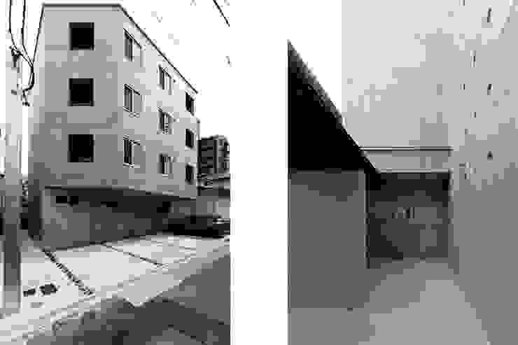 CO2WORKS Casas estilo moderno: ideas, arquitectura e imágenes Concreto Gris