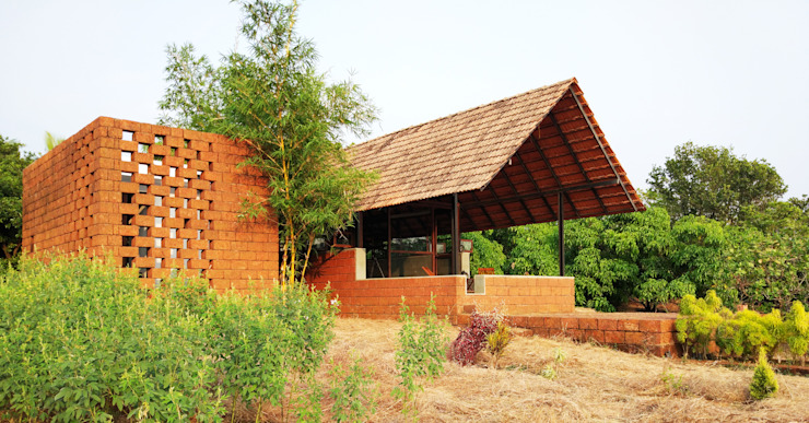 Vrindavan, weekend home at Sindhudurg by unTAG Architecture and Interiors Asian