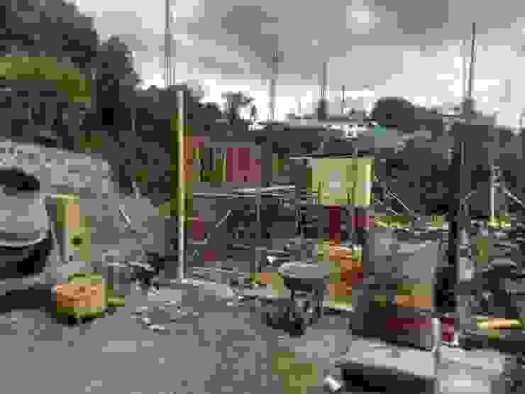 Casa de Descanso Chachagüí Paredes y pisos de estilo rural de Grupo Cadcom Constructores SAS Rural