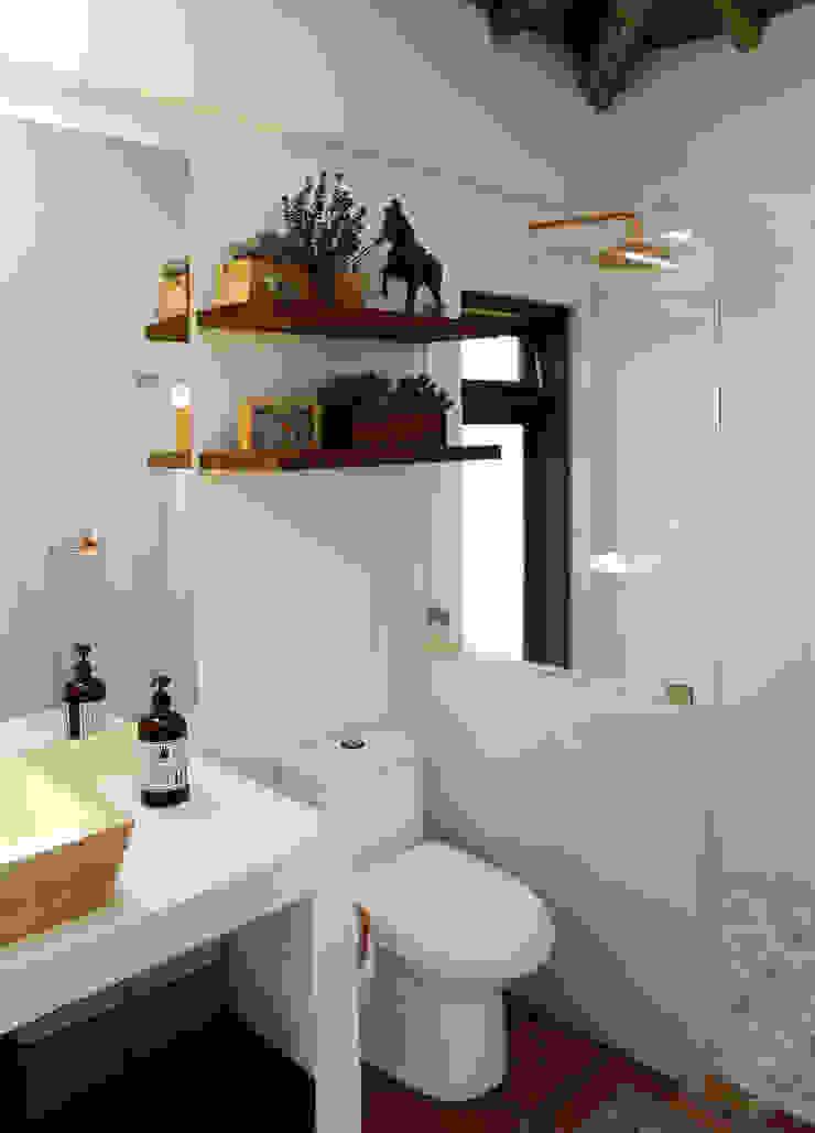 Casas de banho rústicas por Gamma Rústico