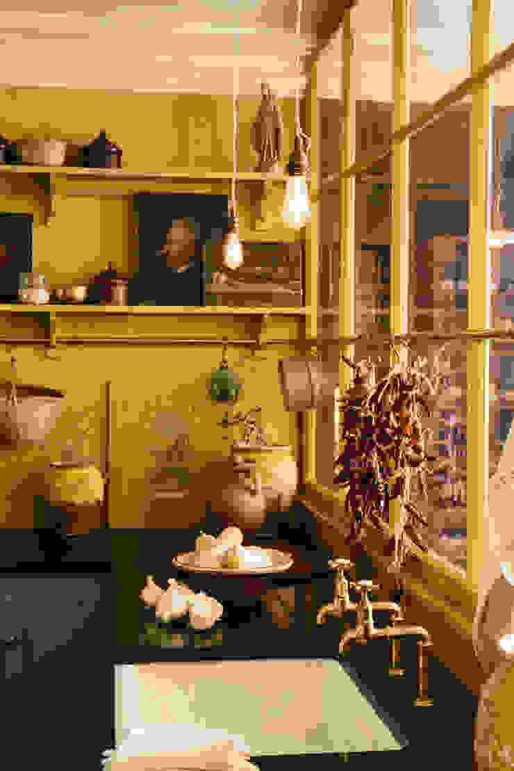 The Bond Street Shaker Showroom deVOL Kitchens Mediterranean style kitchen Yellow