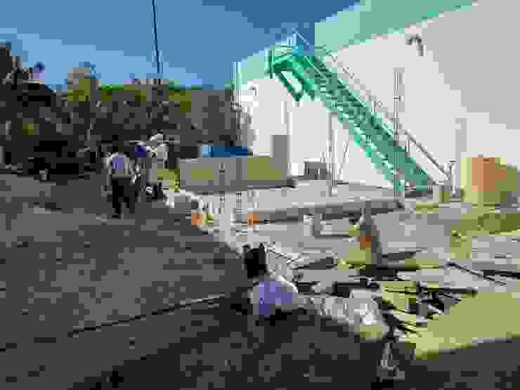 Caseta de Planta de Tratamiento, Cancun Casas industriales de JO'O ARQ Industrial