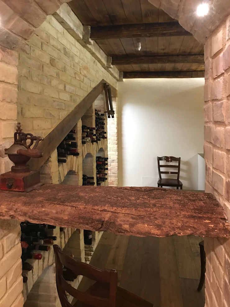 Rustic style wine cellar by Laura Marini Architetto Rustic Bricks