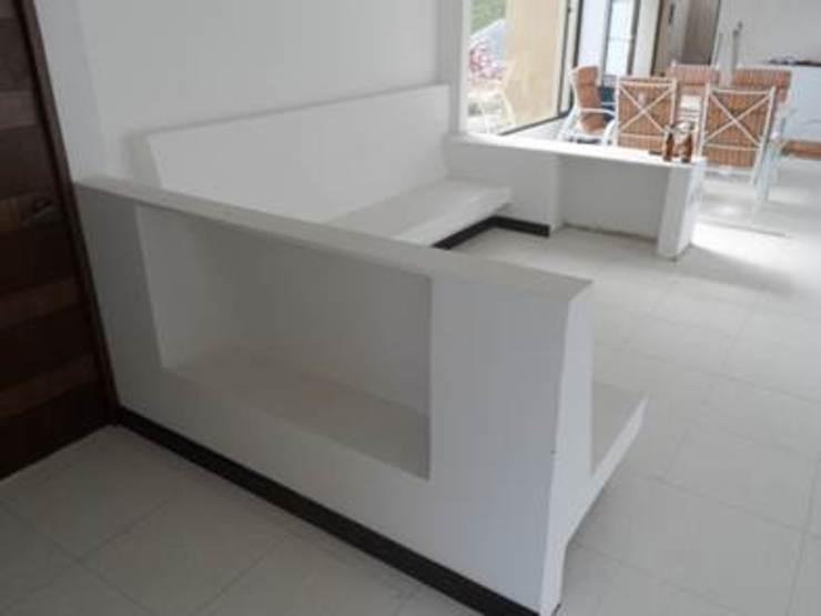 Sala en mampostería Salas modernas de NetCom Construcciones Moderno