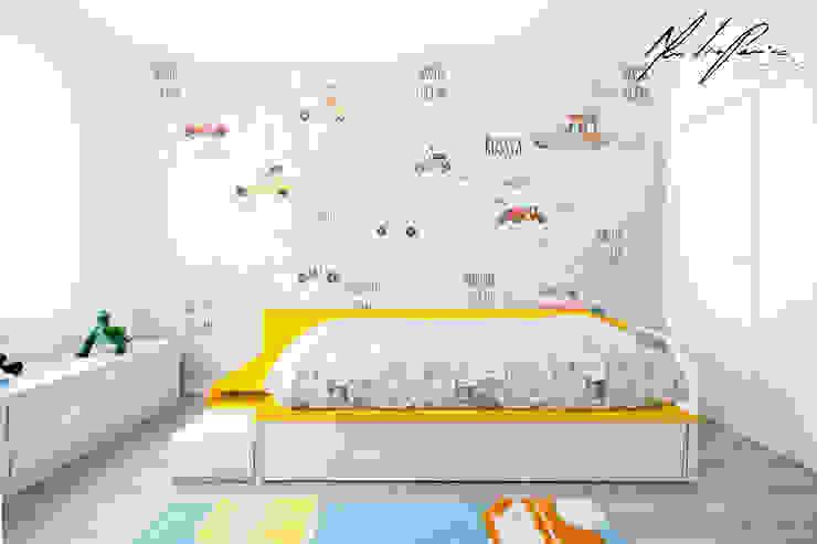 logotipo Quartos de criança minimalistas por Mariline Pereira - Interior Design Lda. Minimalista