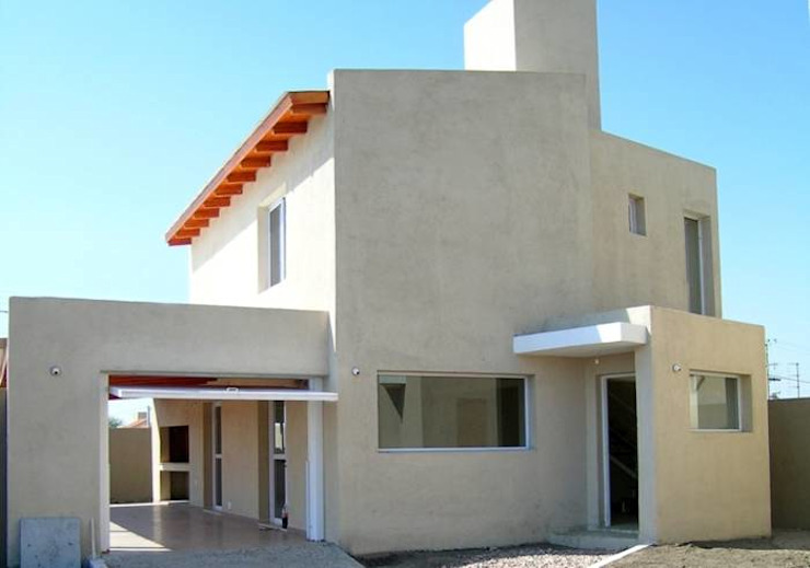 Rojas Guri Arquitectos Rumah keluarga besar Batu Bata Beige