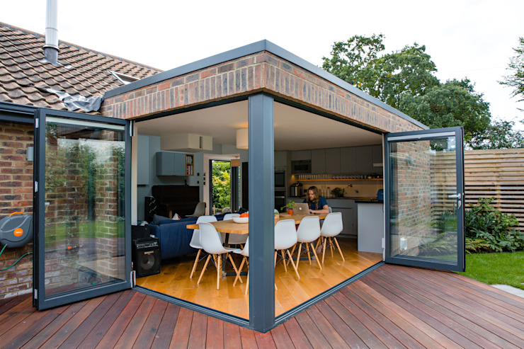 Exterior view of extension, bi-folding doors and outdoor terrace dwell design Modern houses