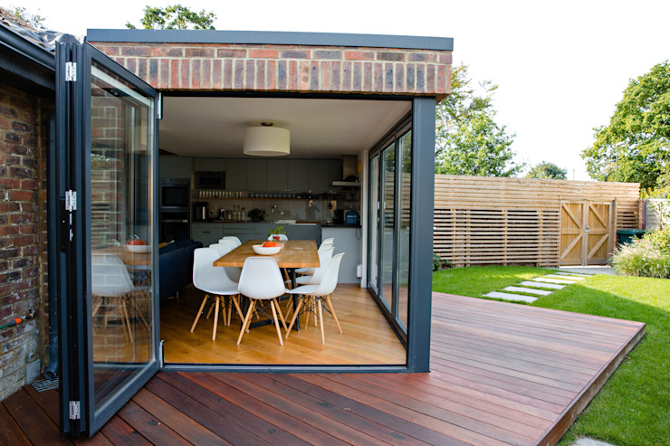Exterior view of extension and bi-folding doors dwell design Modern houses