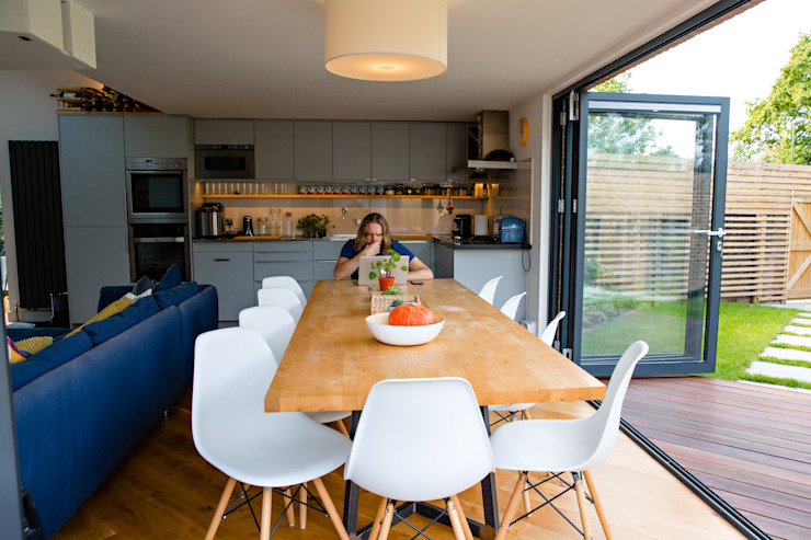 View of dining and kitchen spaces from bi-folding doors dwell design Modern dining room
