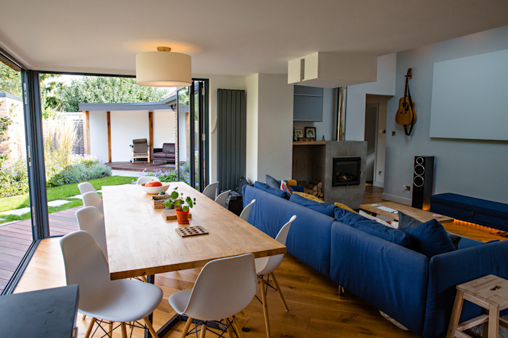 View of open-plan dining and living spaces from kitchen Modern Yemek Odası dwell design Modern