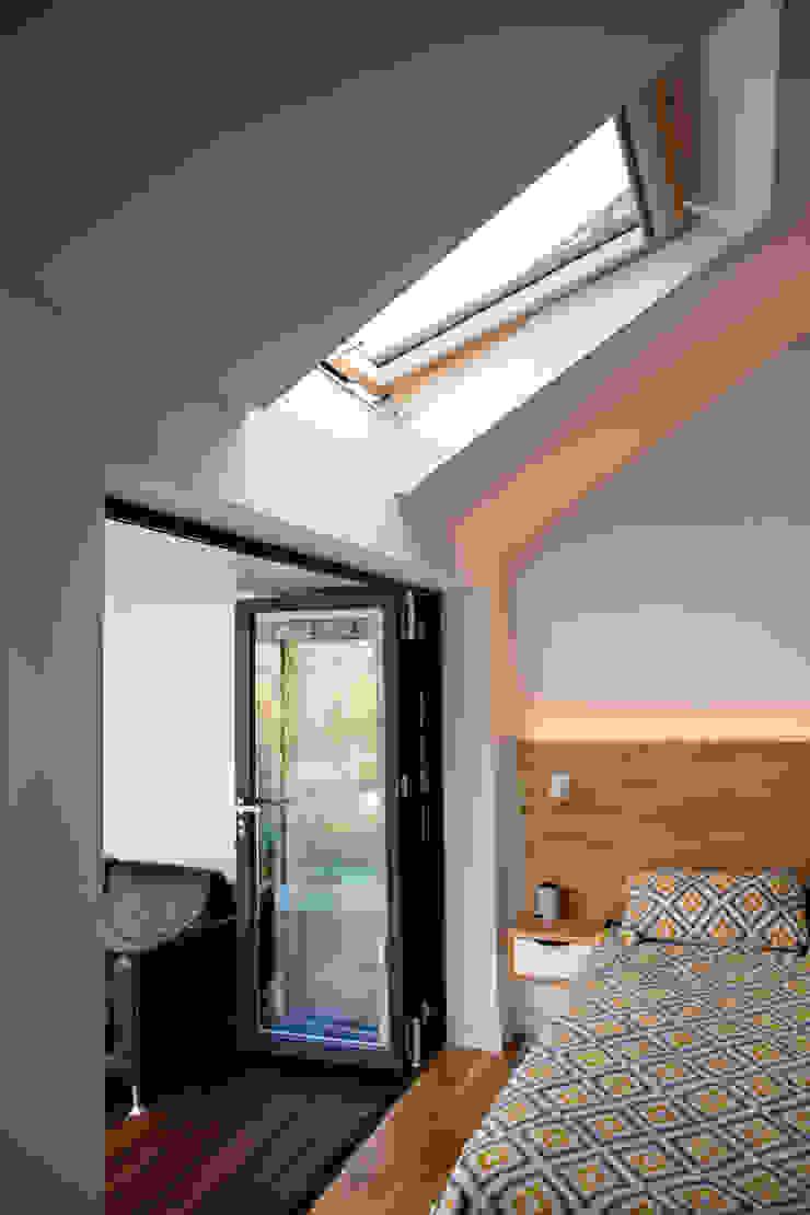 View of bi-folding doors and roof window in master bedroom dwell design Modern style bedroom