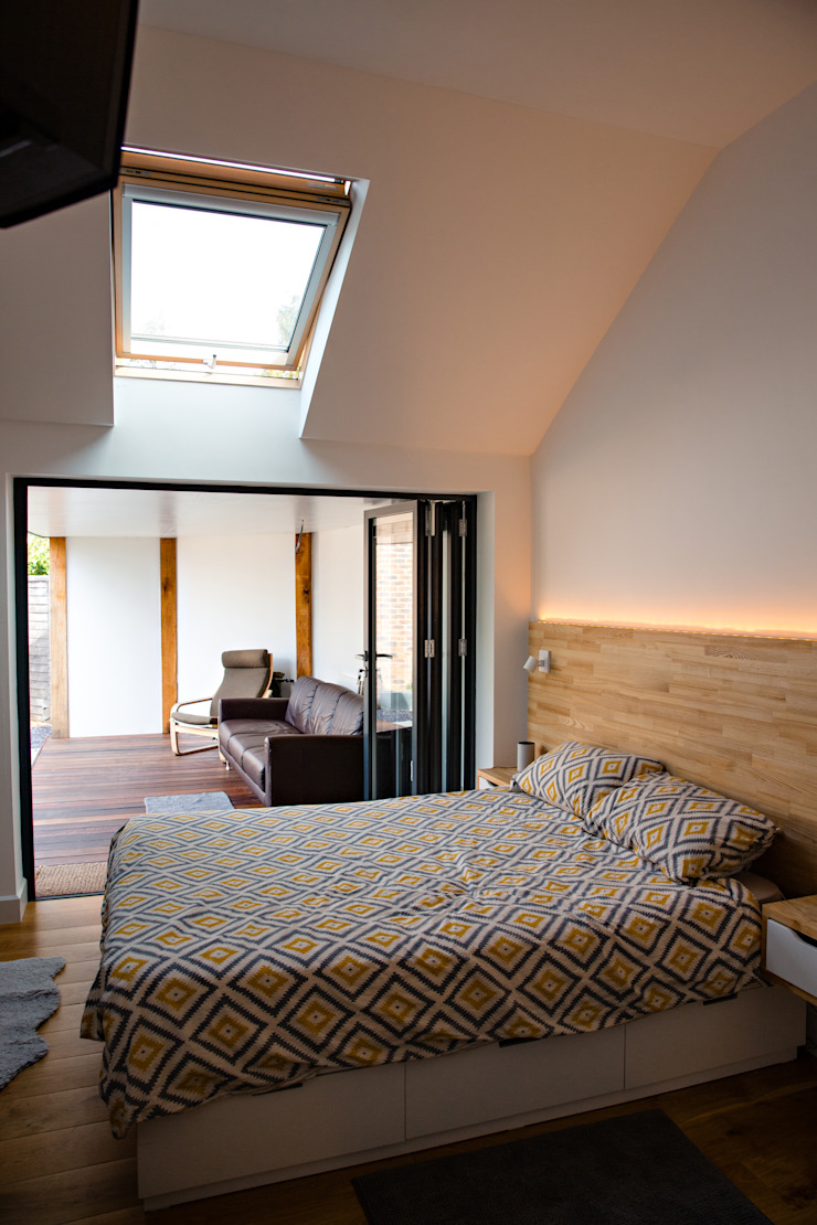 View of bi-folding doors, roof window and feature lighting dwell design Modern style bedroom