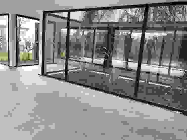 Moderne woonkamers van Maximiliano Lago Arquitectura - Estudio Azteca Modern