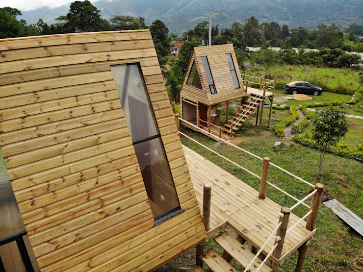 by TALLER DOS ARQUITECTOS Country Solid Wood Multicolored